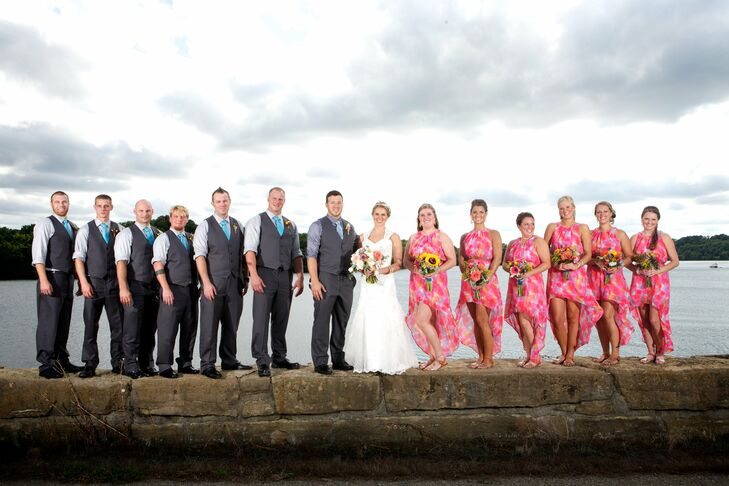 The bridesmaids wore vibrant pink watercolor print dresses, with a trendy hi-low skirt.