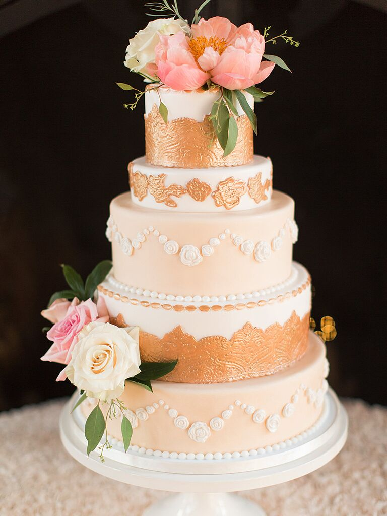 Elegant gold wedding cake with roses and peonies