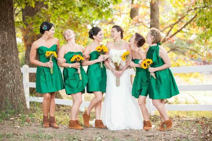 Brittany's bridesmaids wore strapless emerald dresses with brown booties and carried clusters of bright sunflowers.