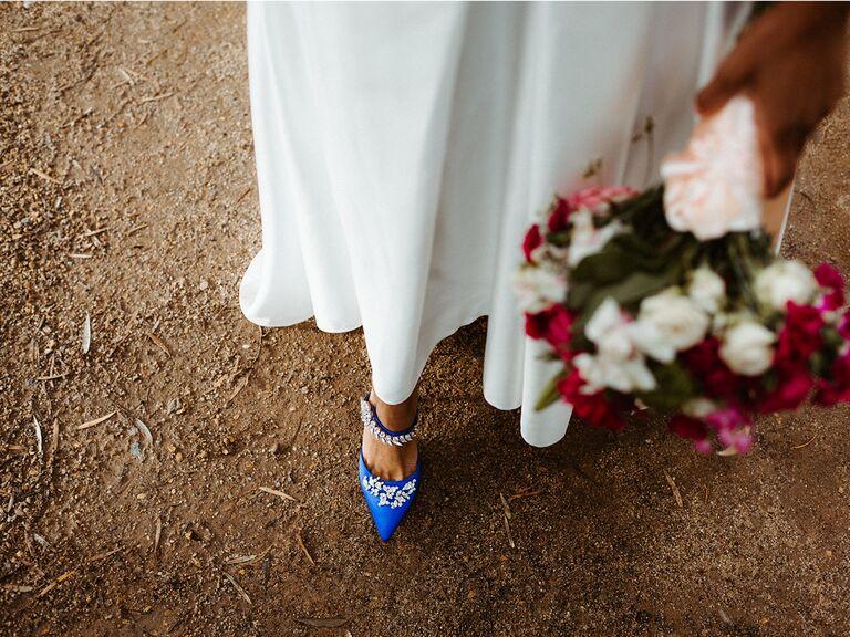 bride wearing blue shoes