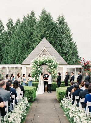 Elegant Ceremony with White Flower Arch at Oregon Golf Club in West Linn, Oregon