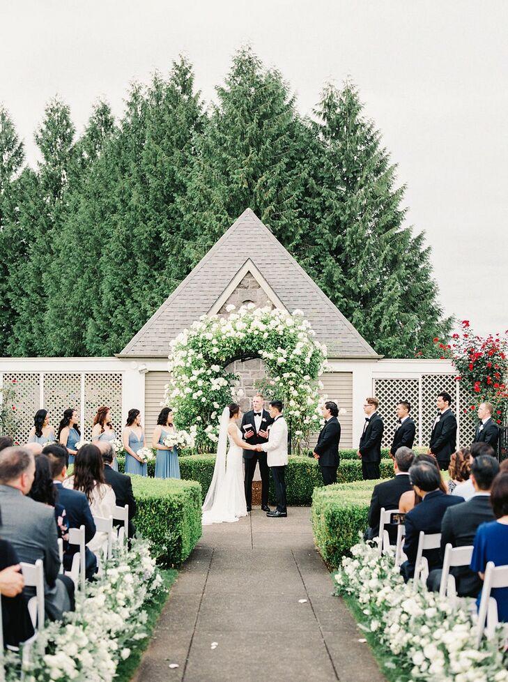 Elegant Ceremony with White Flower Arch at Oregon Golf Club in West Linn, Oregon