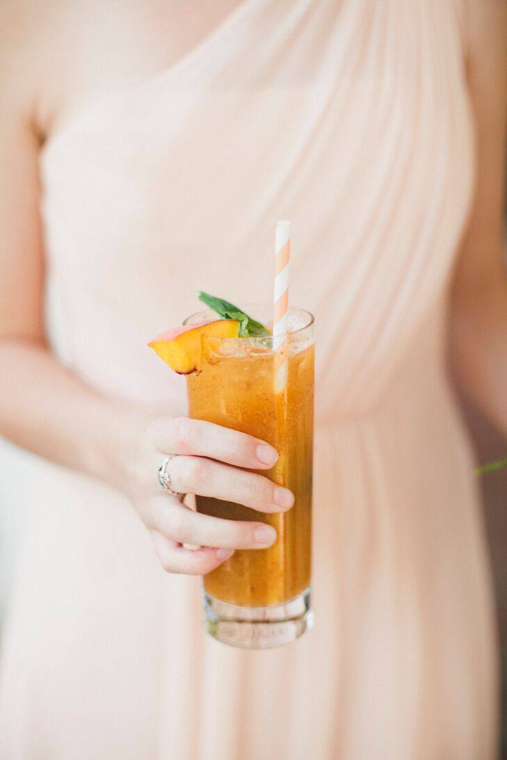 Playing off the wedding's peach theme, Molly and Patrick treated guests to peach mojitos during cocktail hour. The vibrant drinks were garnished with fresh peaches and mint and finished with playful peach-striped straws.