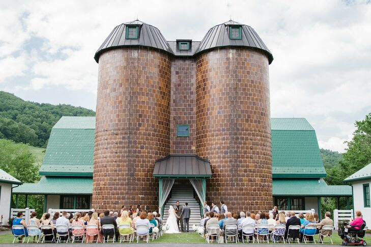 """The venue was gorgeous, so we didn't have to decorate much for the ceremony except for some shepherd's hooks and hydrangeas along the aisle,"" Blair says of their outdoor ceremony, which took place on the lawn in front of the Old Dairy barn at the Homestead Preserve in Warm Springs, Virginia."