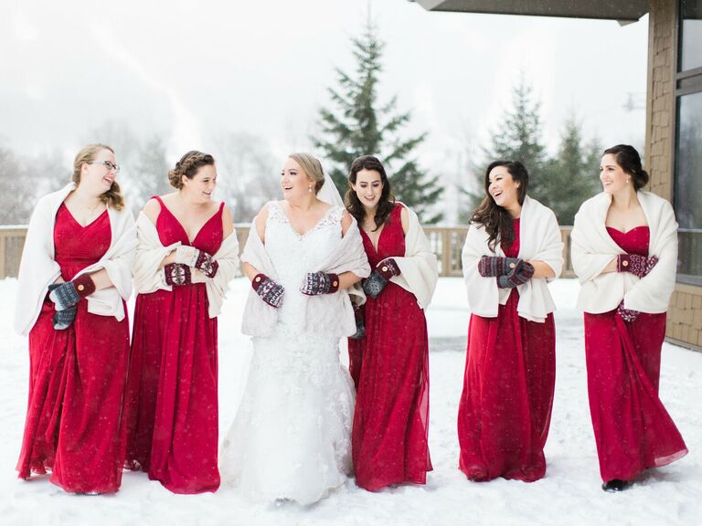 bride and bridesmaids wearing wraps