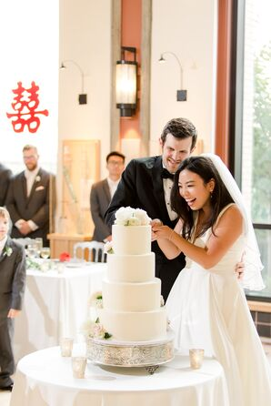 Traditional Cake Cutting with Tiered White Fondant Cake
