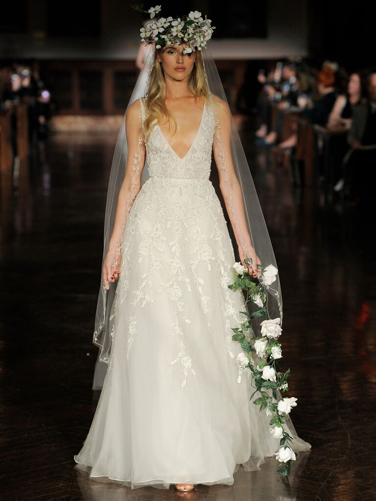 Reem Acra Spring 2019 beaded wedding gown with plunging neckline and empire waist