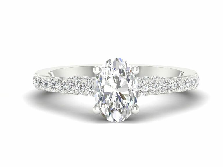 Jenny Packham oval diamond engagement ring in solitaire setting with diamond pave band