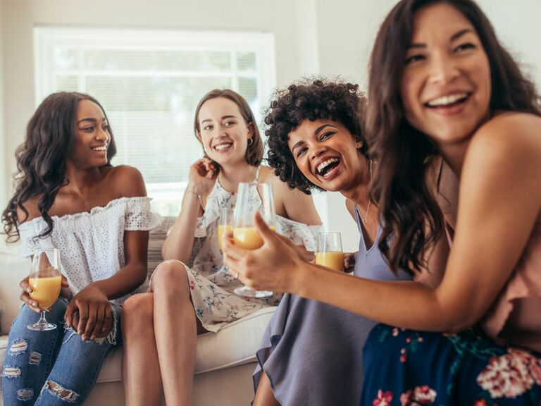 Group of girl friends playng games at bachelorette party