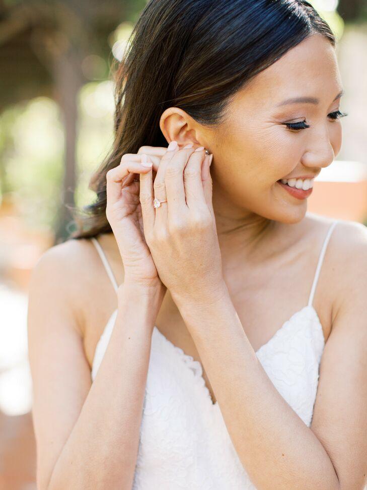 Bride Putting on Earrings for Wedding at Rancho Las Lomas in Silverado, California