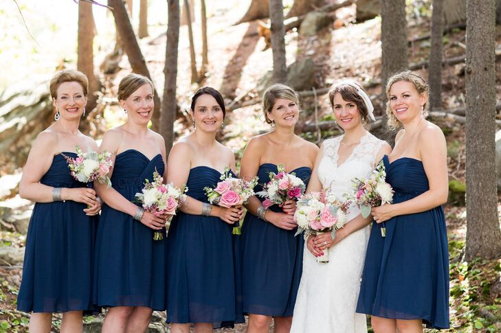 The bridesmaids wore simple and elegant strapless, cocktail-length navy dresses.
