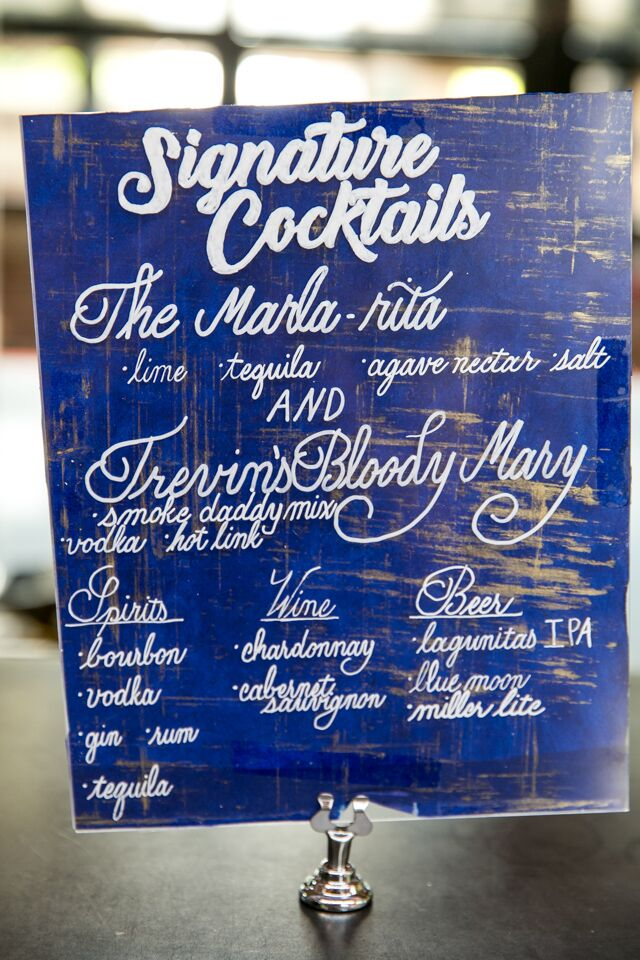 His and hers cocktails were the Marla-rita and Trevin's Bloody Mary. The cocktails were displayed on a blue wooden sign.