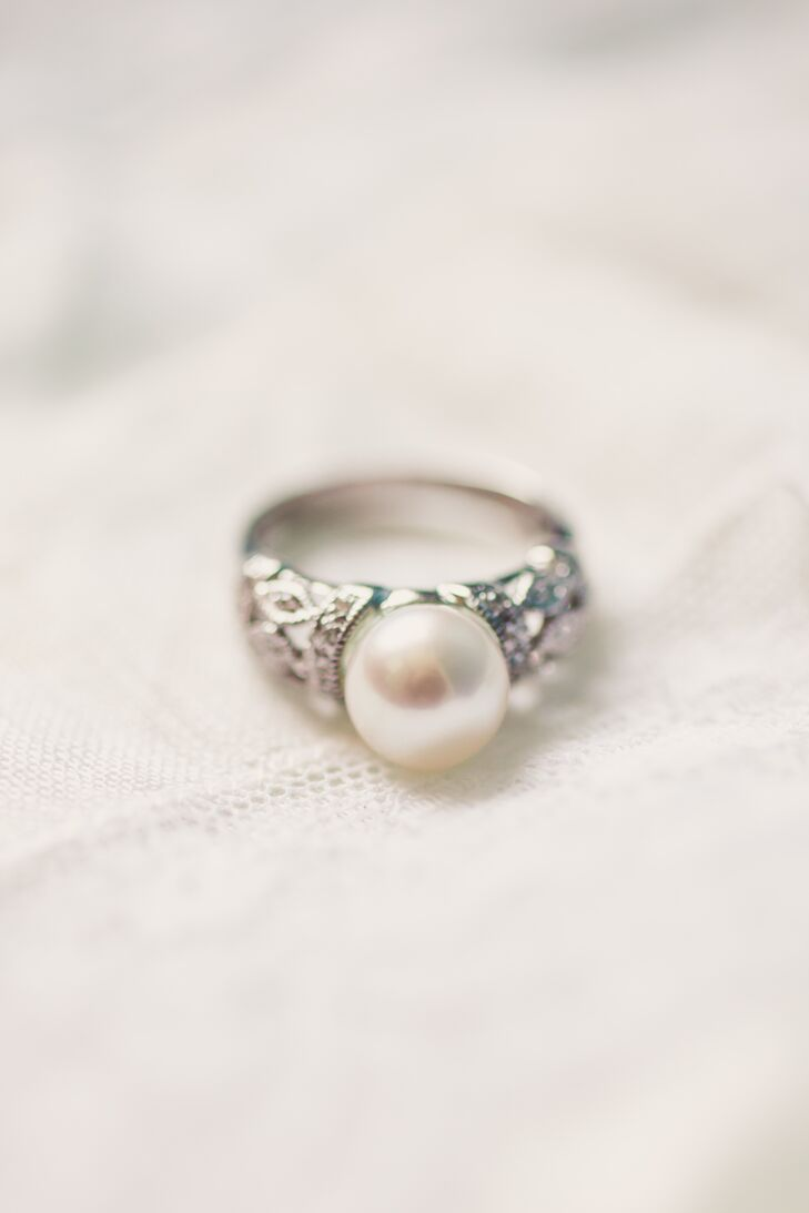 "Doug found Kim's antique diamond and pearl ring, a combination of the pair's birthstones, from an estate jeweler in Florida (Gesner Estate Jewelry). ""He felt it suited my taste and knew I preferred an antique ring as opposed to a modern design,"" says Kim."