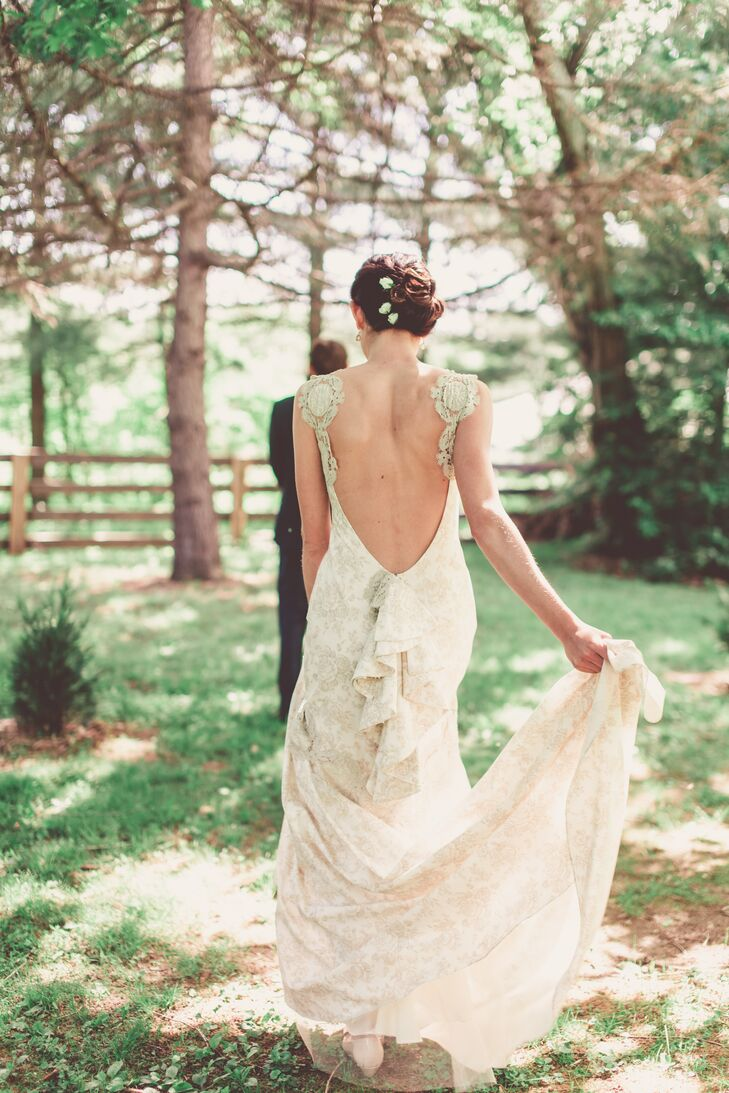 The bride wanted something a little off-beat, so she chose a Claire Pettibone dress with a deep V-back. Her shoes were light pink leather with a matching bow.
