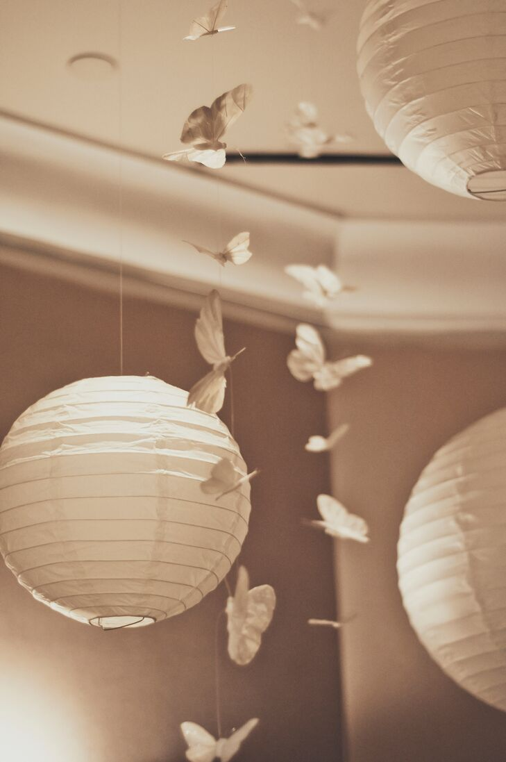 White paper lanterns and white paper butterflies hung above the reception tables.