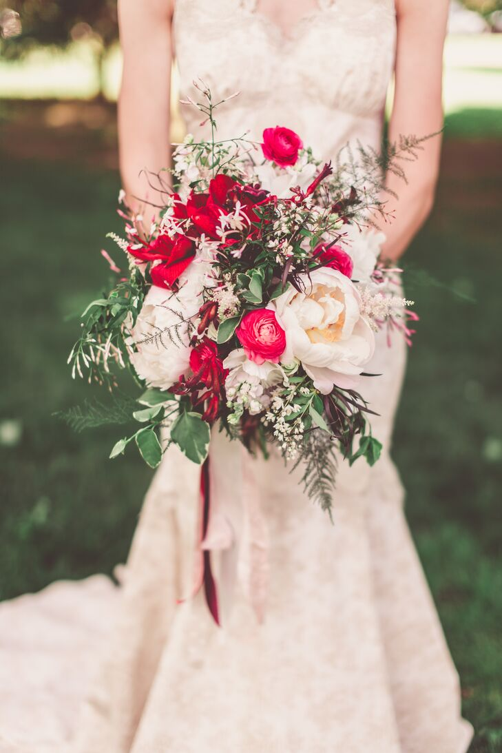 The bride consulted Crimson and Clover for her bouquet, requesting pops of white, red, purple and pink. The bursts of color stood out against the couple's natural, green lawn.