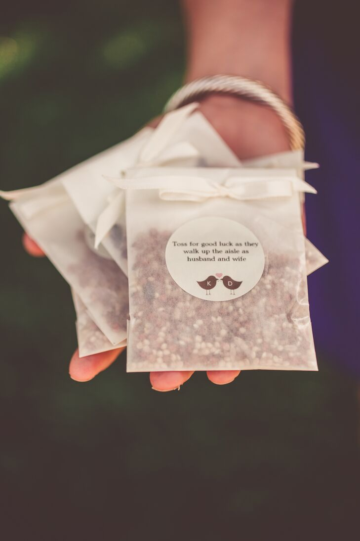 """We really love watching our backyard birds from our porch, so we thought a bird theme would be perfect for a backyard wedding,"" says Kim. Rather than the traditional rice recessional throws, the couple passed out bags of birdseed that read ""Toss for good luck as they walk up the aisle as husband and wife."""