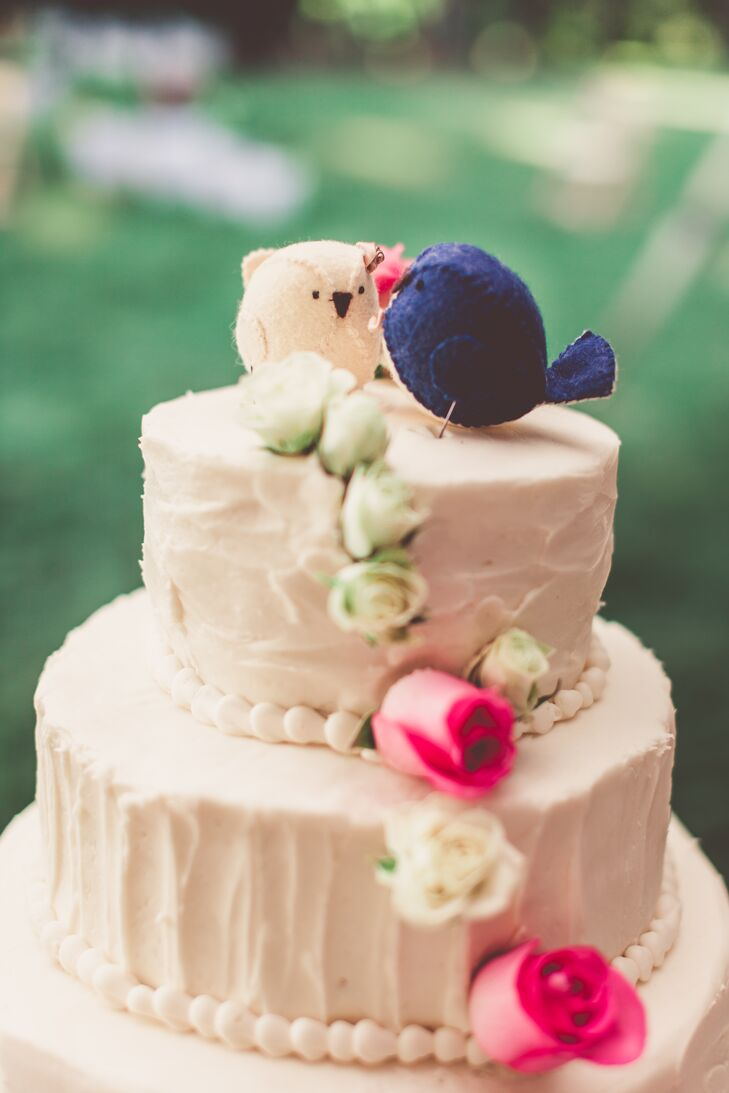 The wedding cake featured a vertical cascade of pink and white roses and two handmade felt birds purchased from Blossom Hill shop on Etsy. The cake itself was a plain pound cake with vanilla buttercream.