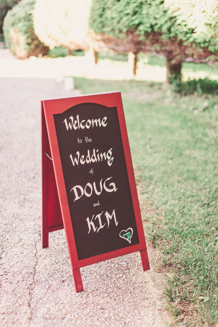 Kim and Doug posted a red and black sign outside their home to welcome guests to their wedding ceremony.