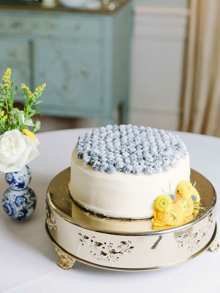 Small one-tier wedding cake with blueberries on top