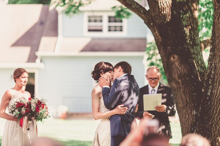 Kim and Doug shared their first kiss as newlyweds in their own backyard under an ash tree.