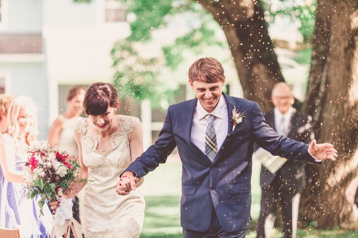 Tapping into the couple's passion for bird watching in their backyard, the wedding guests tossed birdseed on the couple as they made their recessional walk.
