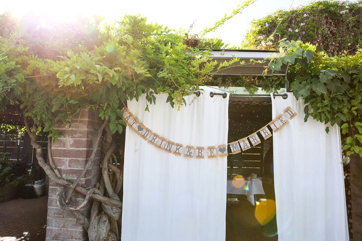 Burlap accents and potted succulents lent a rustic feel to the alfresco affair.