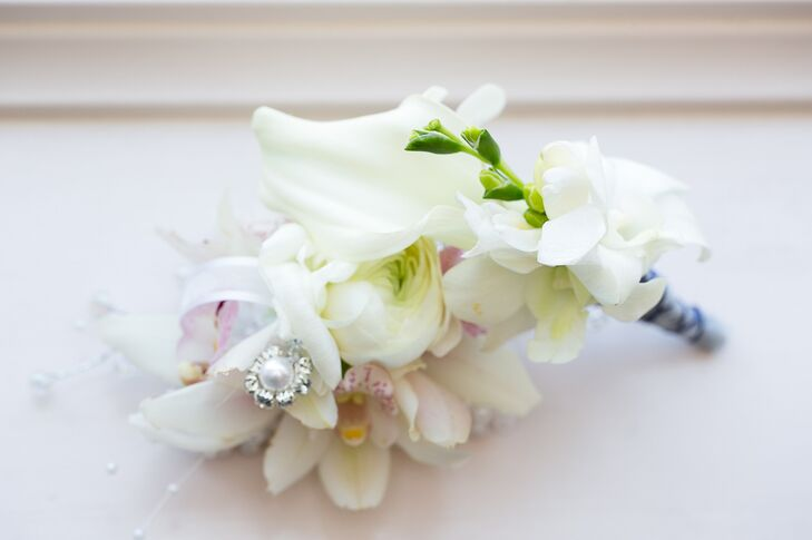 Aaron's white boutonniere included orchids and stephanotis.