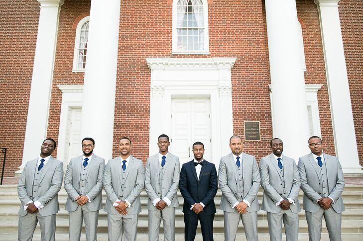 The groomsmen wore gray J.F. Ferrar suits with navy ties. Aaron wore a custom Indochino tuxedo.