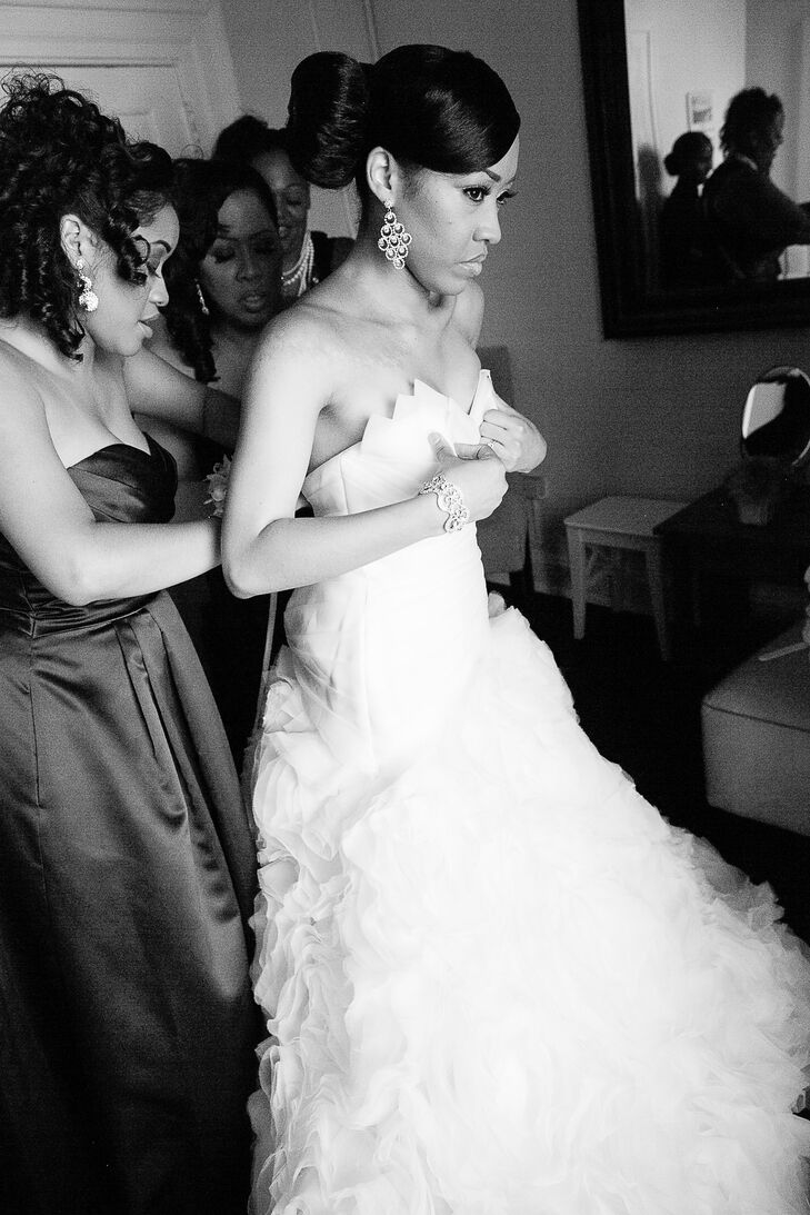 Vashit wore a Maggie Sottero wedding dress in the style of Jalissa, with a sweetheart neckline and dramatic, full skirt with rosettes cascading down throughout the train.