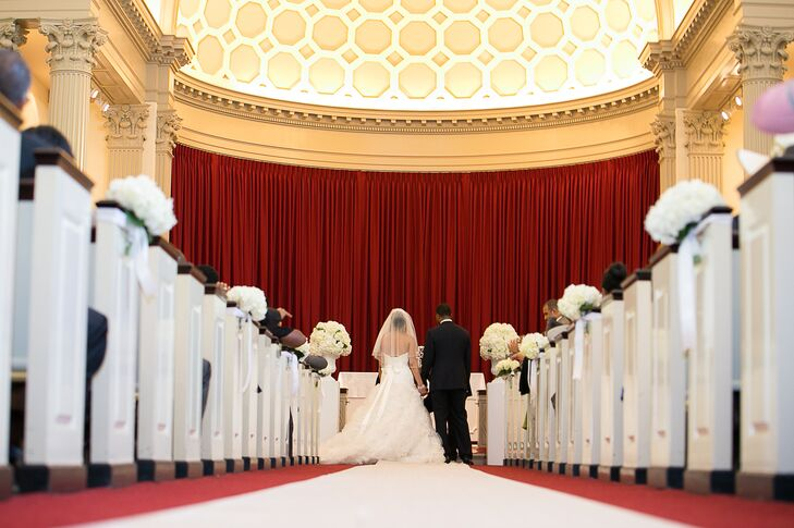 The ceremony was held at University of Maryland's beautiful Memorial Chapel. The pews were decorated with arrangements of white hydrangeas.