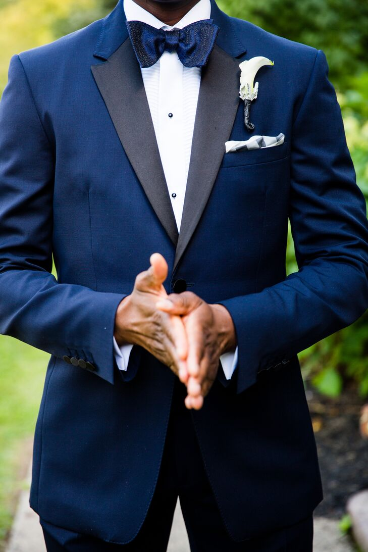 Barry wore a navy Burberry tuxedo with satin lapels paired with an Eton formal shirt with a plisse front. To top the look, he wore a Thomas Pink navy bow tie and a white pocket square.