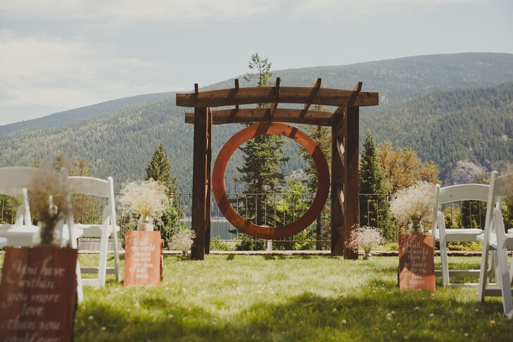 Greg's father built the incredible arbor that Jessica and Greg stood under when they exchanged their vows. Wooden signs with inspiring, romantic quotes lined the aisle, adding a romantic touch to the ceremony decor.
