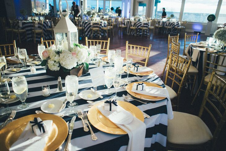 """With their venue boasting a waterfront location in the old seafaring town of Newport, Rhode Island, it seemed appropriate to organize the wedding's design around a nautical theme. """"I have a deep love for New England, the ocean and everything it represents,"""" Yecelin says. """"That's why I wanted an elegant, nautical-themed wedding, and what better place than Newport?"""""""