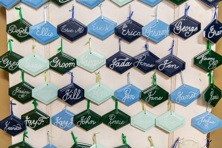 """Guests' names were painted on porcelain tiles in the wedding's color scheme. These served as the escort cards and favors. Seeing the tiles hanging in friends' and families' homes after the wedding """"has been such an honor,"""" Marla says."""