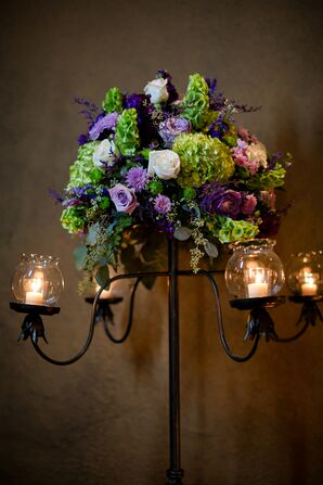 Lush Flower Arrangement on Black Candelabra