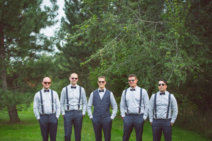 John and his groomsmen kept their look casual and simple thanks to button-down shirts and suspenders from Express.