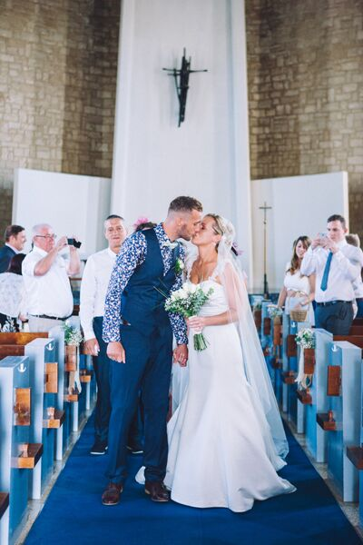 Romantic Kiss Down the Aisle After Cyprus Ceremony