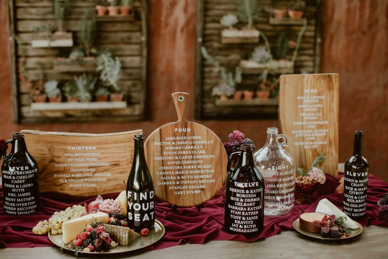 Hand-lettered wood cutting boards for seating chart display