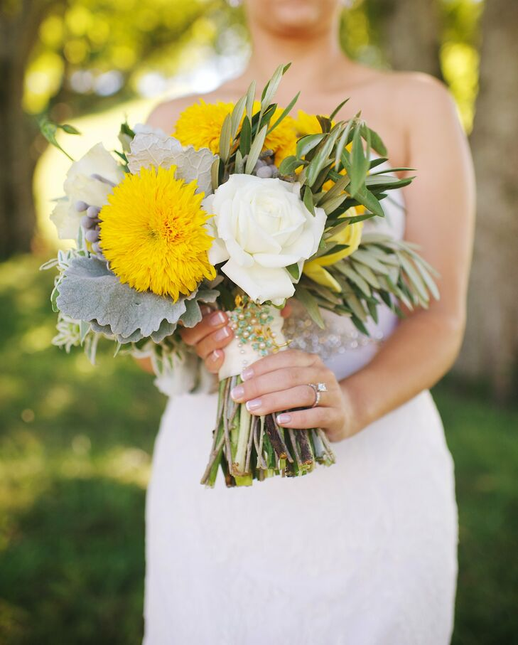 Jenni carried a bright bouquet with yellow mums and white roses. The bouquet was fastened with ribbon and a pretty broach. The bouquet was designed by Caroline Jones from Mint Springs Farm.
