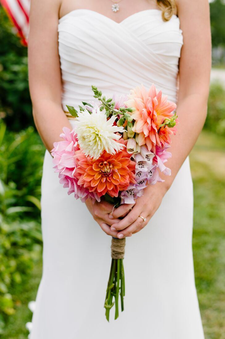 Meredith's bouquet was filled with bright pink and coral dahlias and pale purple fox glove, which were gathered from her neighbor's and mother's gardens.