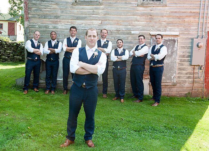 Sam and his groomsmen wore navy linen vests and ties opting not to wear the matching jackets to better match the casual atmosphere of the barn wedding at Maple Shade Farm.