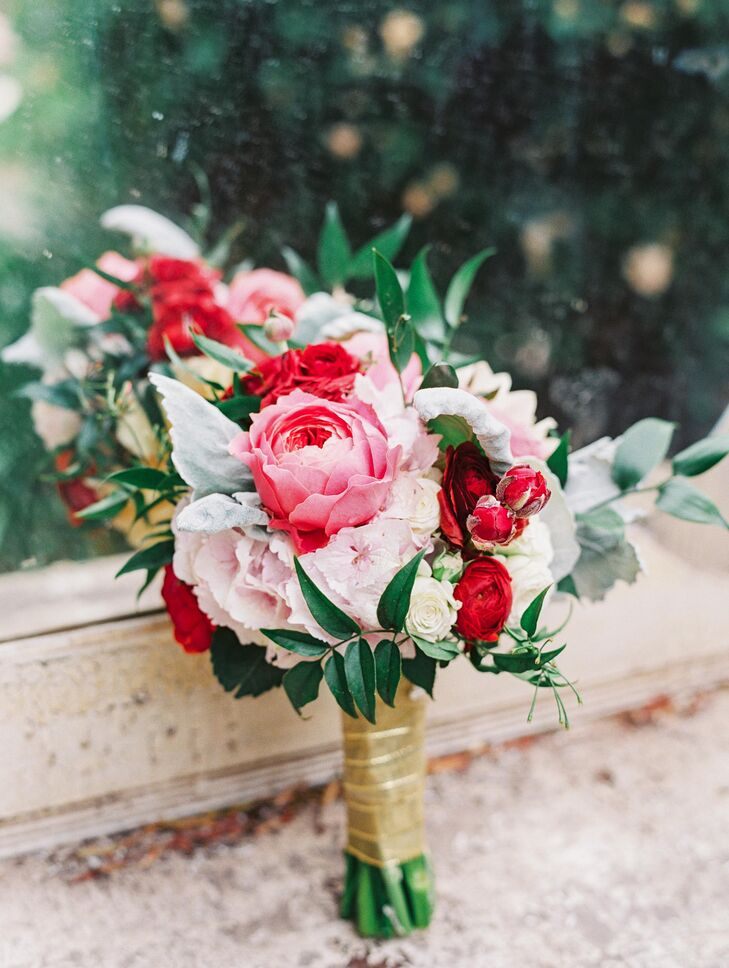 The bridesmaids had pops of pink color incorporated into their romantic-looking bouquets, made up of peonies, roses, dahlias and dusty miller. The bouquets had gold wraps holding the flower arrangement together.