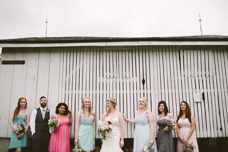 """""""I wanted my bridesmaid gowns to reflect the many colors found in rosemaling,"""" Mary says. All the bridesmaids wore knee-length dresses in different colors and different styles."""
