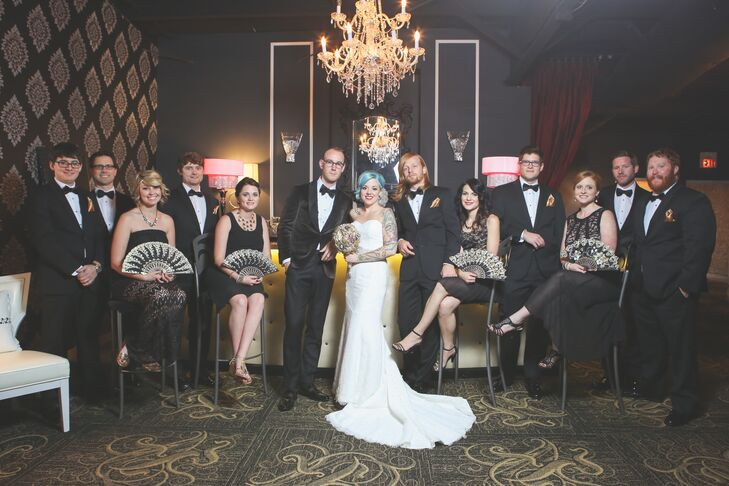 """Our wedding party reflected a modernized style of the 1920s with the gals in different variations of lace black dresses and gold fans instead of bouquets,"" says Jana. ""The gents completed the look in black tuxedos with suspenders and gold pocket squares."""