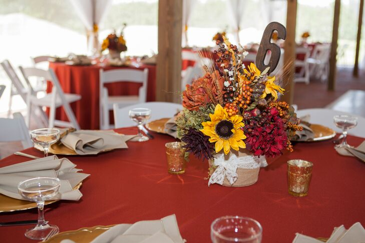 With the overall theme of a rustic barn wedding in mine, the venue incorporated fall colored flowers and decorations, such as lace, burlap, and mason jars.