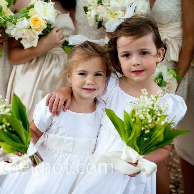 The two flower girls wore dupioni silk dresses with organza sashes and carried lily of the valley bouquets.