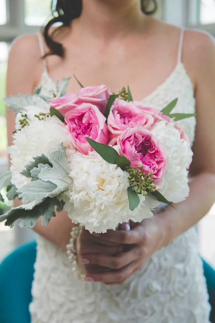 Nicole carried a bouquet with bright pink roses and white peonies.