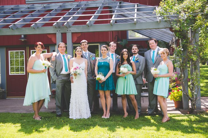 The bridesmaids wore dresses in shades of turquoise and sea foam. The groomsmen wore gray suits with turquoise ties.