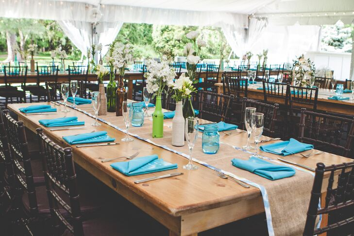 Farmhouse Tables with Blue Linens and Burlap Runners at Tented Reception